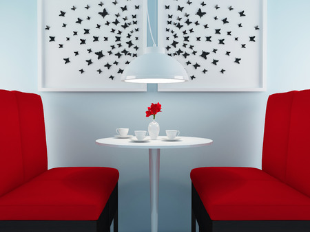 Modern cafe design. Contemporary dining room. Round table with tea cups and flowers. photo