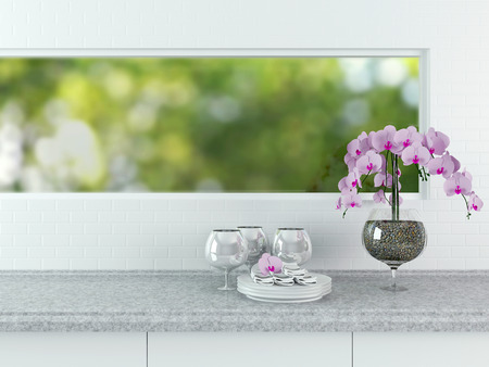 Ceramic tableware on the worktop in front of big window. White kitchen design.