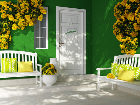Front view of a wooden white door on a green house with window. Beautiful yellow roses and benches on the porch. Entrance of a house.