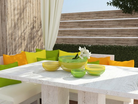 seating area: Outdoor patio seating area with big sofa, color pillows and table.