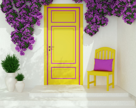 Front view of yellow door on a white house with window. Beautiful purple roses and chair on the porch. Entrance of a house. photo