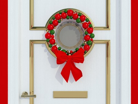 Classic home door decorated with balls wreath for the holiday. Reklamní fotografie