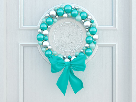 Classic home door decorated with blue balls wreath for the holiday. photo