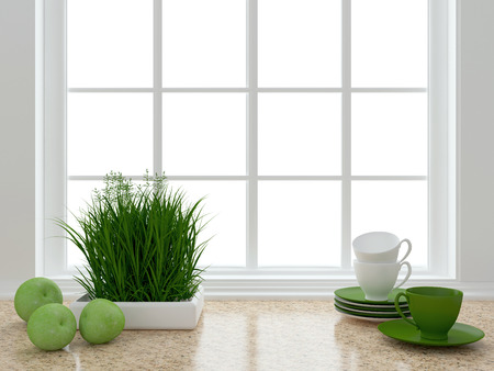 Cups, plant and apples on the marble worktop in front of big window. White kitchen design.