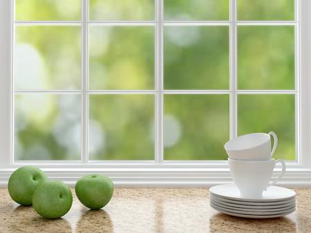 カップと大きなウィンドウの前面に大理石のワークトップのリンゴ。