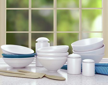 worktop: Kitchen utensils on the marble worktop. White ceramic plates.