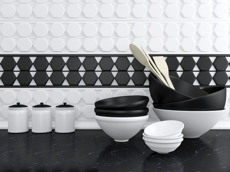 Kitchen utensils on the marble worktop. White and black ceramic kitchenware.