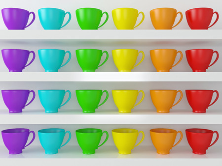 Rainbow ceramic cups on the shelves in front of white wall.