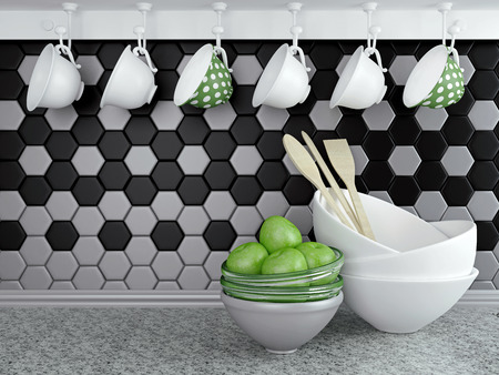 kitchen tiles: Kitchen utensils on the marble worktop. Ceramic and glass kitchenware in front of modern wall tile.