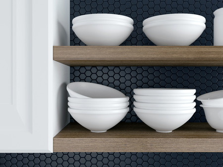 Fragment of interior of modern black and white kitchen. Kitchenware on the wooden shelves.