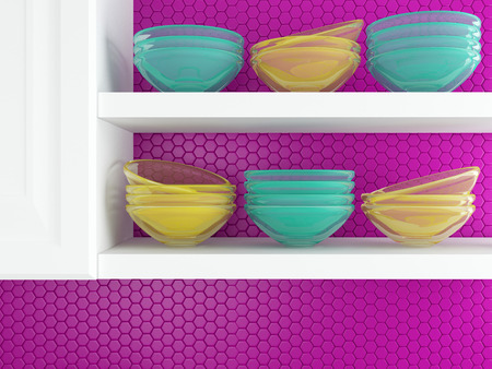 Fragment of interior of modern kitchen. Kitchenware on the white shelves.