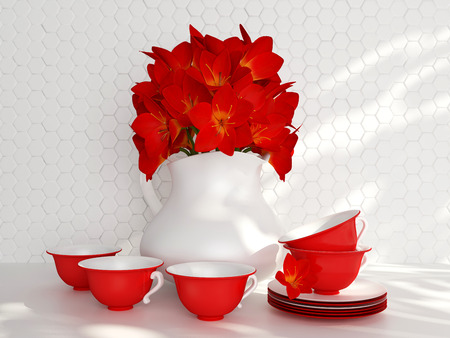 Kitchen still life. Ceramic vase with red flowers and tea cups on the table in front of white till wall.