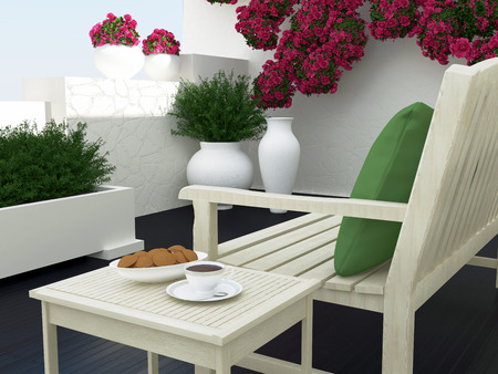 Outdoor patio seating area with light wooden furniture, roses and green plants.