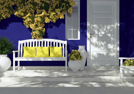 Front view of white door on a dark blue house with window. Beautiful yellow roses and bench on the porch. Entrance of a house. Redakční
