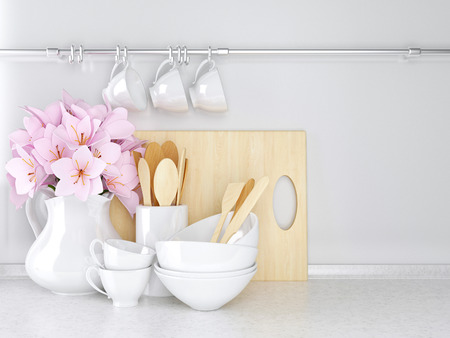 worktop: Wooden and ceramic utensils with flowers on the white marble worktop. Stock Photo