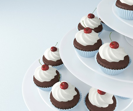 Chocolate cupcakes with ice-cream and cherries on a white ceramic stand.