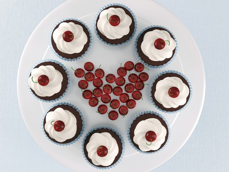 Chocolate cupcakes with ice-cream and cherries on a white stand.