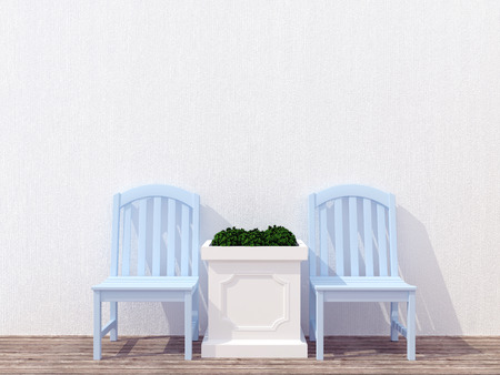 upmarket: Outdoor patio seating area with blue wooden furniture, white wall.