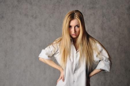 deg: discontented girl in white male shirt Stock Photo