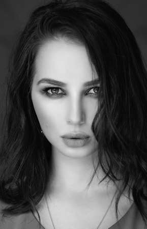 portrait of a woman with dark hair and makeup on her face Reklamní fotografie