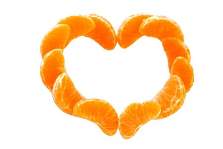 The Heart from tangerine. The Segments of the tangerine are insulated on white background. Stock Photo - 6132510