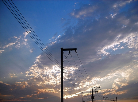 Electric posts and blue sky background photo