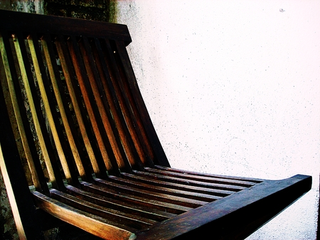 Wooden old chair. Textured background photo