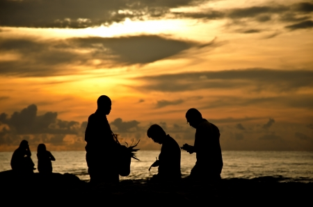 Silhouette sunrise of Monk and Buddist on the sea  photo