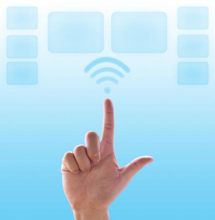 Hand pushing wireless on cyan background photo