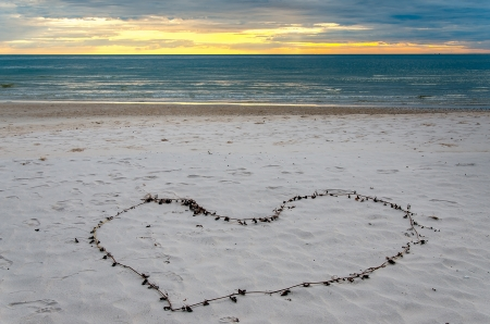 Heart-shaped decoration on the beach photo