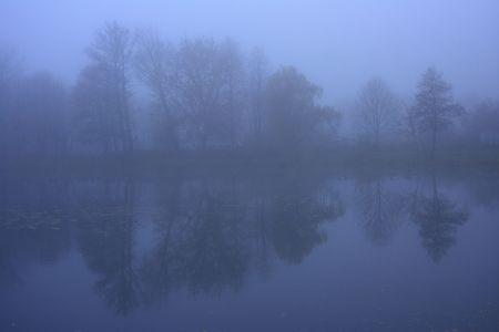majesty: Road on a dam by the lake in the mist Stock Photo
