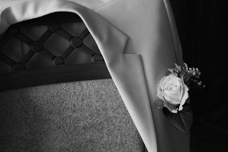 bridegrooms: Bridegrooms jacket on a chair, black and white Stock Photo