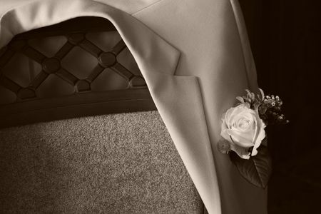 bridegrooms: Bridegrooms jacket on a chair, sepia
