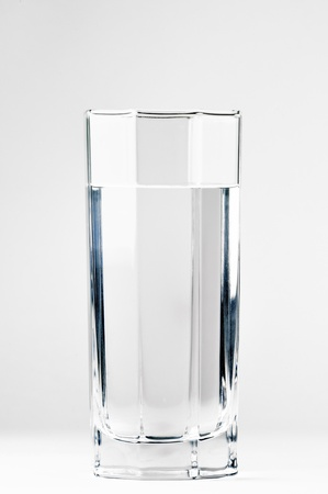 With a glass of water on a white background
