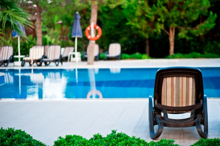Chaise lounge by the pool to relax in the villa. photo