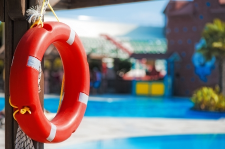 Lifebuoy hanging on a wooden beam at the poo