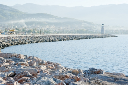 Landscape with a lighthouse in the harbor town of Alanya at dawn. Stock Photo - 15935349