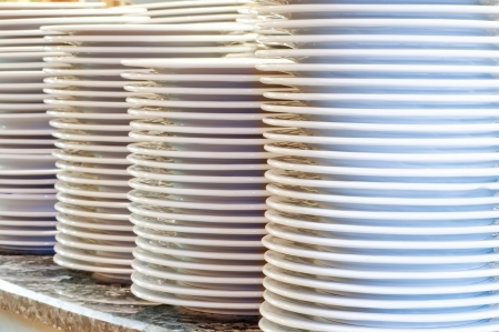 clean dishes: Piles of clean utensils Stock Photo