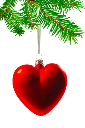 Christmas tree decorations in the form of heart on a Christmas tree branch