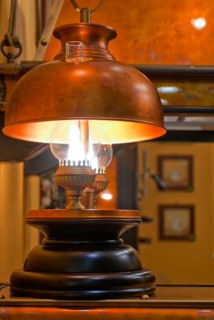 Old kerosene lamp with copper shade Stock Photo - 16468864