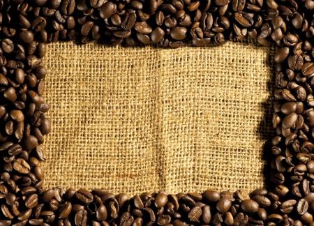 Frame of coffee beans on sacking photo
