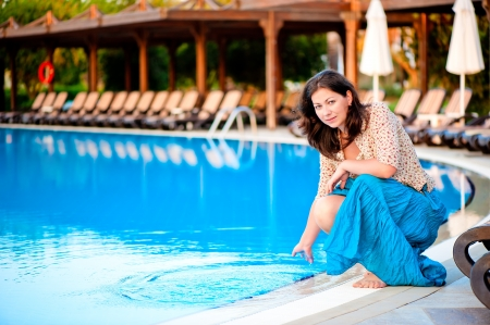 Beautiful young girl at the pool Stock Photo - 16711601