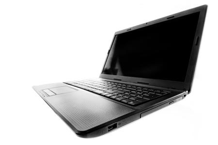 Black laptop open on a white background. photo