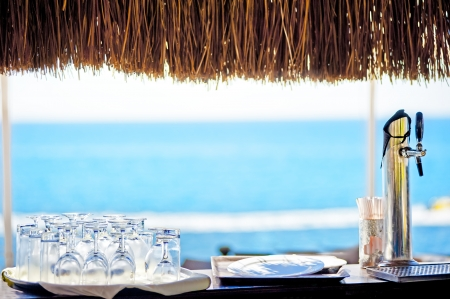 Empty rack bar with sea view Standard-Bild