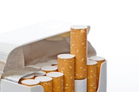 Open pack of cigarettes on a white background Stock Photo