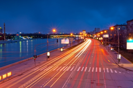 lights from the headlights in motion blur postural evening. Frundzenskaya embankment of the Moscow River. Moscow. photo