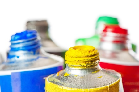 conjunction: Tubes of oil paint open in conjunction