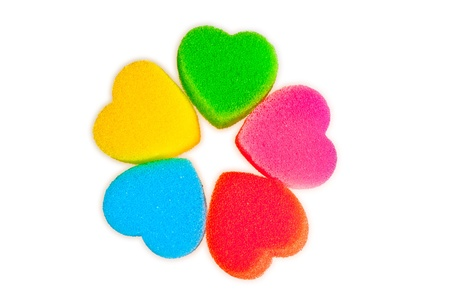 Flower of colored hearts on white photo