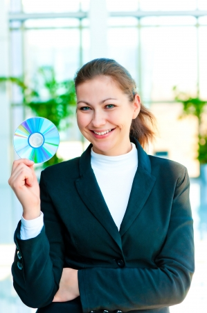 Young happy business woman with a CD in hand Stock Photo