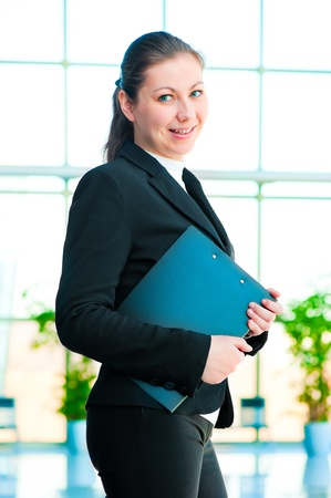 Young happy business woman holding a folder office photo